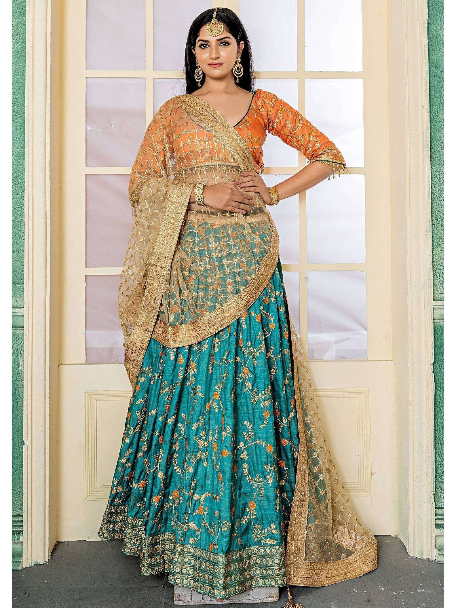 Turquoise Heavy Embroidered Bridal Phantom Silk Lehenga Choli