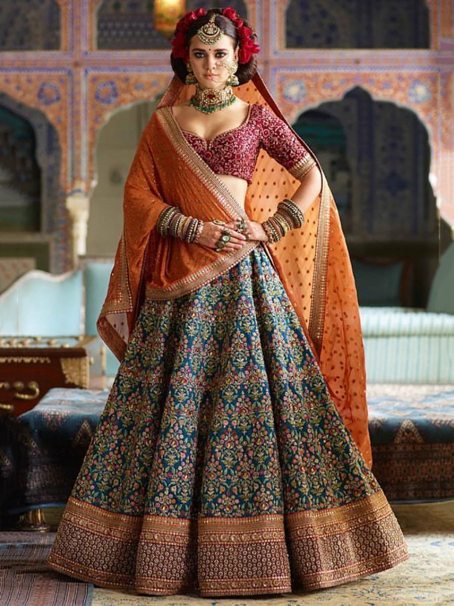 Blue Heavy Embroidered Silk Wedding Lehenga Choli