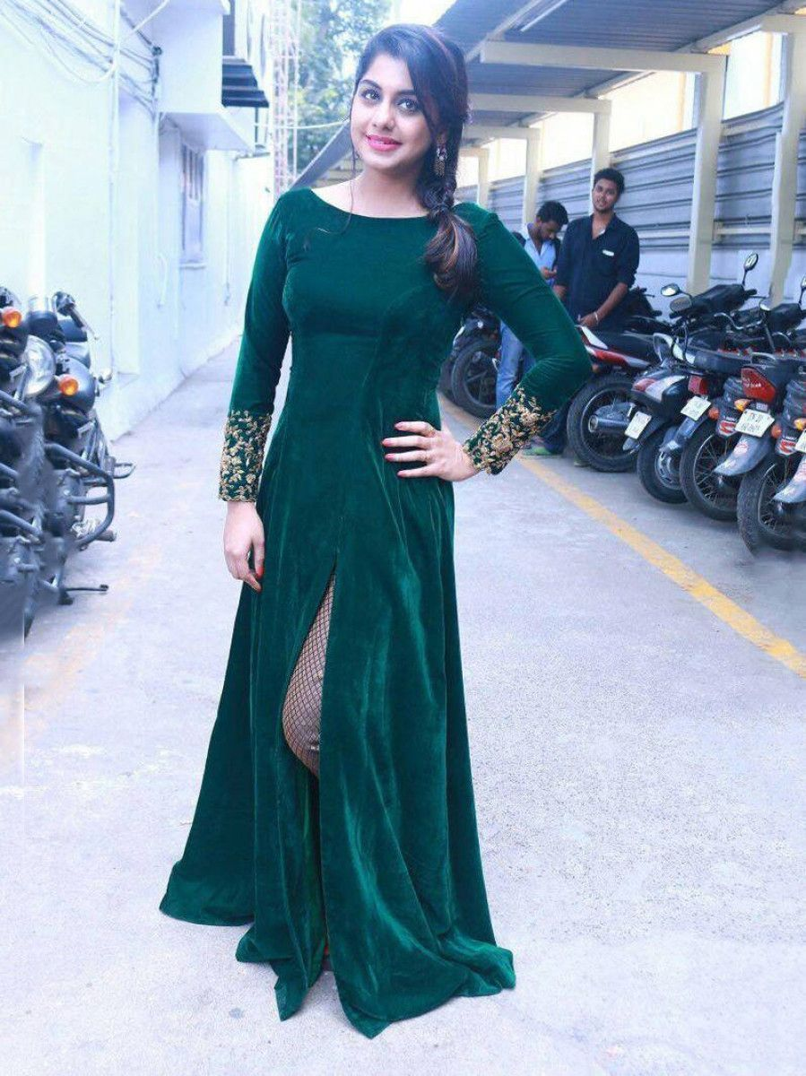 Green Embroidered Velvet Party Wear Side Cut Gown